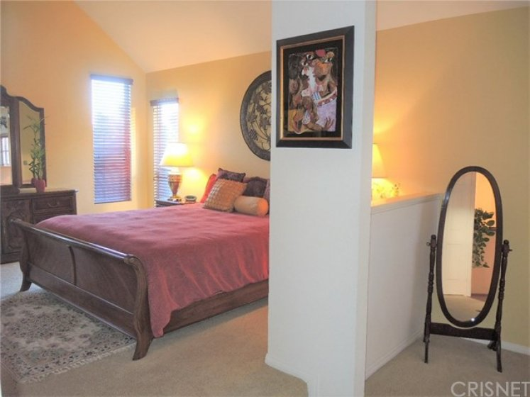 Step-up master bedroom showing partial sitting area