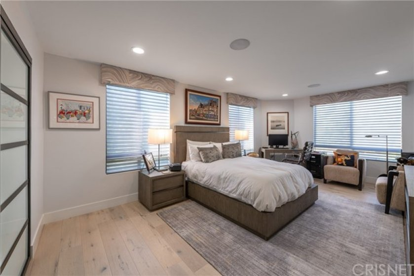 Huge Master Suite w/ Custom Cabinetry Built In, Loads of Closet Space, Hunter Douglas Auto Shades w/Valances, Super Quiet Corner End Unit. Surround Sound In Master Bedroom for In Bed Movie Time & Just Relax.