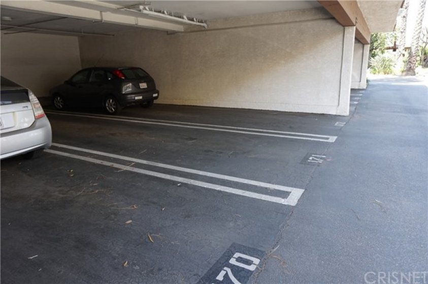 2 assigned tandem parking spots under carport