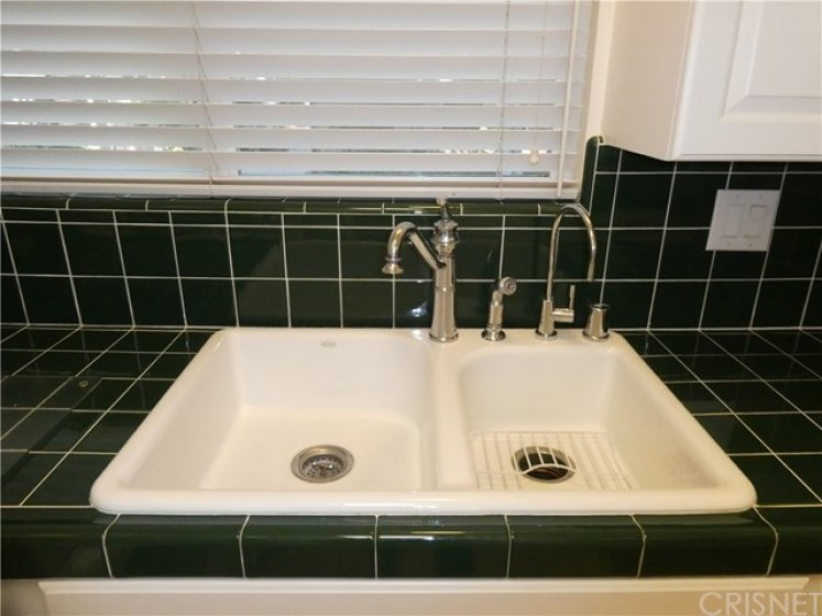 Quality kitchen fixtures and hardware, included water filter.