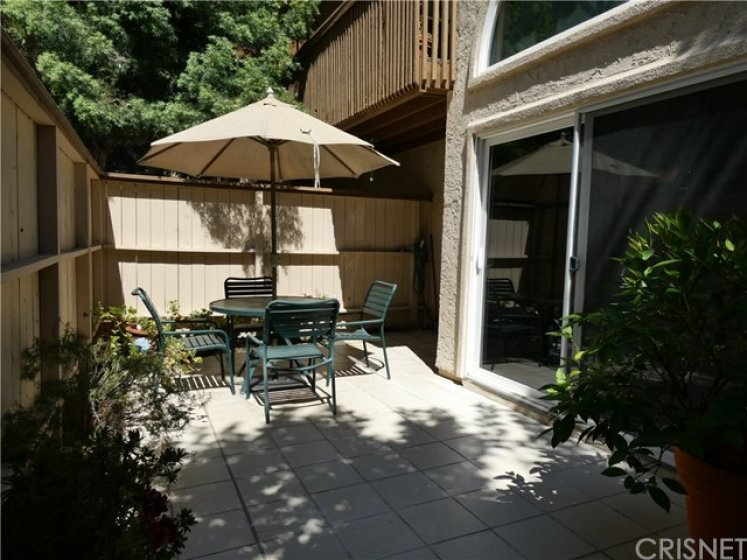 Large private tiles patio