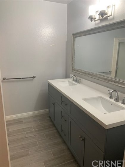 Recently Updated Master Bathroom with new tiles, dual sink vanity and mirror