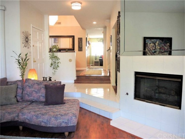 View from sunken living room into hallway to family room in the back, accentuating angles and shapes