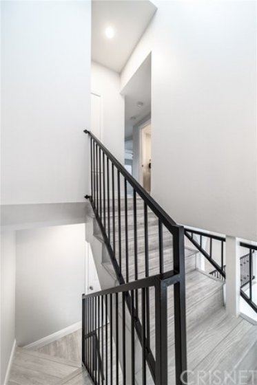 View of the railing going to the third level
