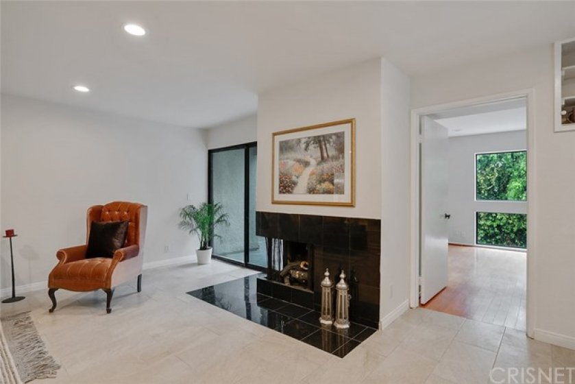 GAS FIREPLACE - SLIDING DOOR LEADS TO PATIO