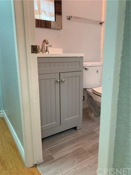 Recently Updated floors and vanity in 2nd Bathroom