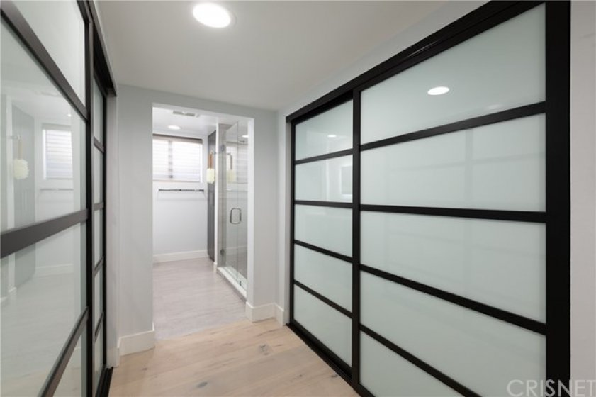 Entrance to The Master Bath w/ More Closet Space. Custom Made Doors & Recessed Lighting Throughout.