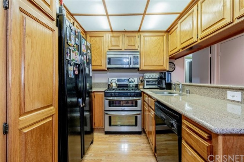 Kitchen has double oven and over range microwave.