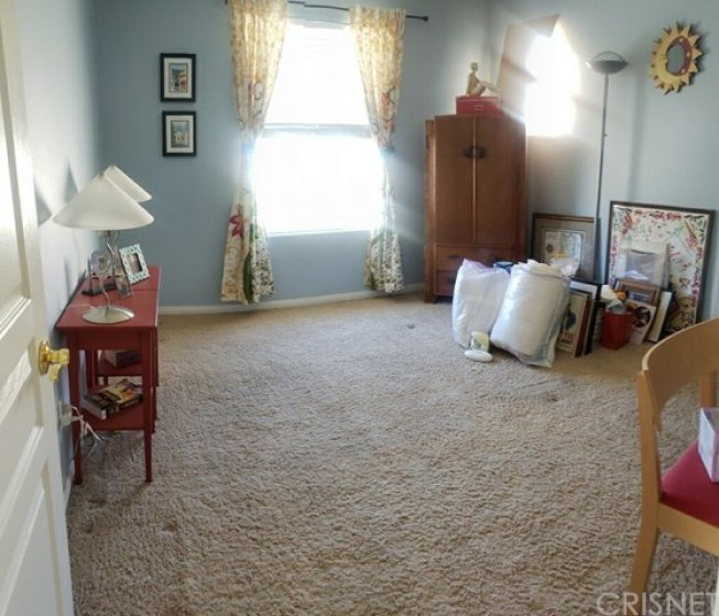 bedroom upstairs - faces front of home