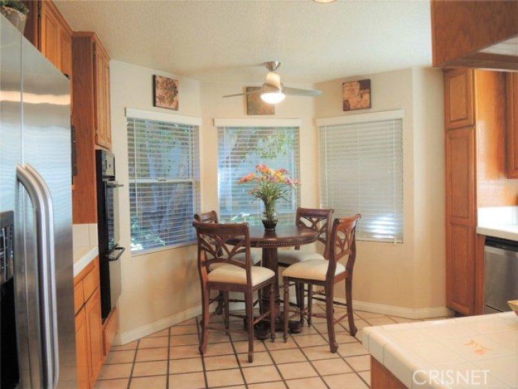 Inviting kitchen eating nook overlooking greenery below