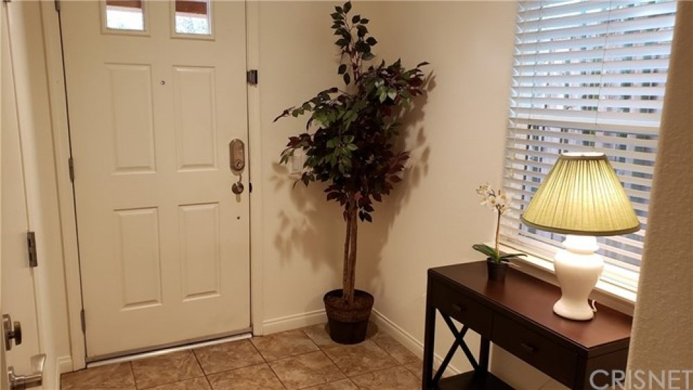 Front entrance door and foyer in your new home. Garage door entrance is to the left.
