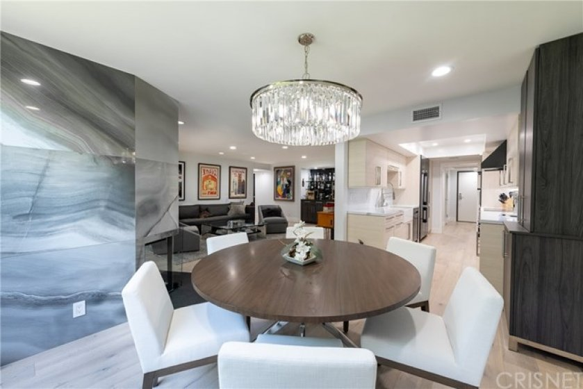 An Exquisite All Marble Floor to Ceiling Fireplace. Extra Wide Eating Area off the Designer Gourmet Kitchen.