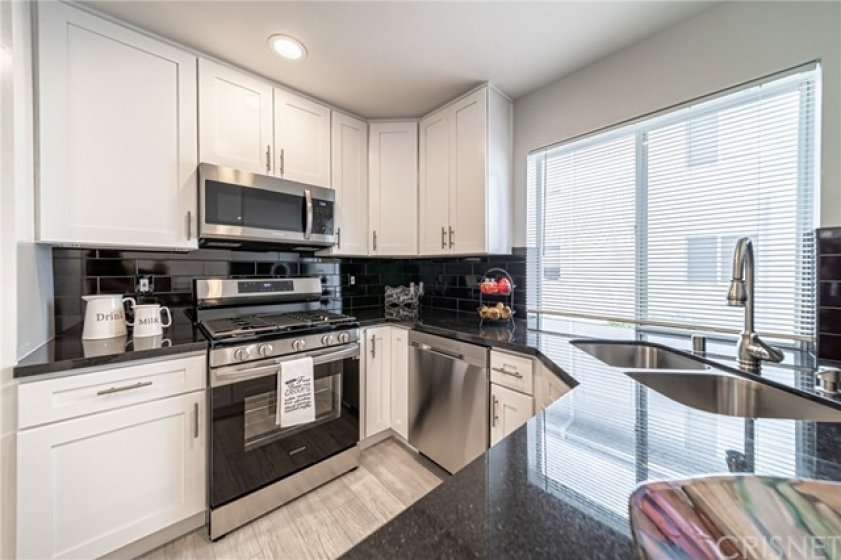 Remodeled kitchen with self closing cabinets