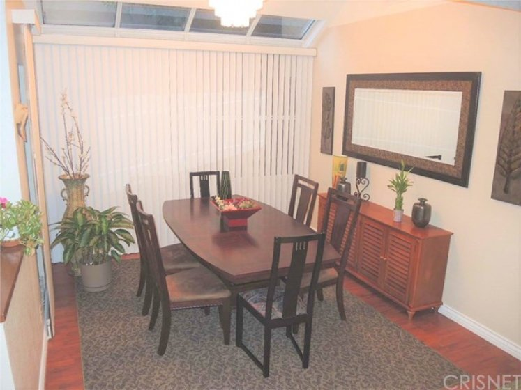 Sun-lit formal dining room is conveniently located between living room and kitchen