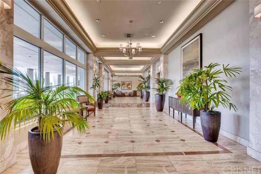 FIRST FLOOR PROMENADE OFF OCEAN BLVD. WALKS OUT TO A 100 FOOT DECK OVERLOOKING THE GRAND PRIX TRACK TURN 9