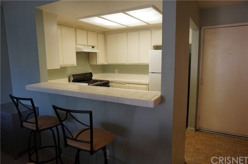 Bar area with kitchen near front door
