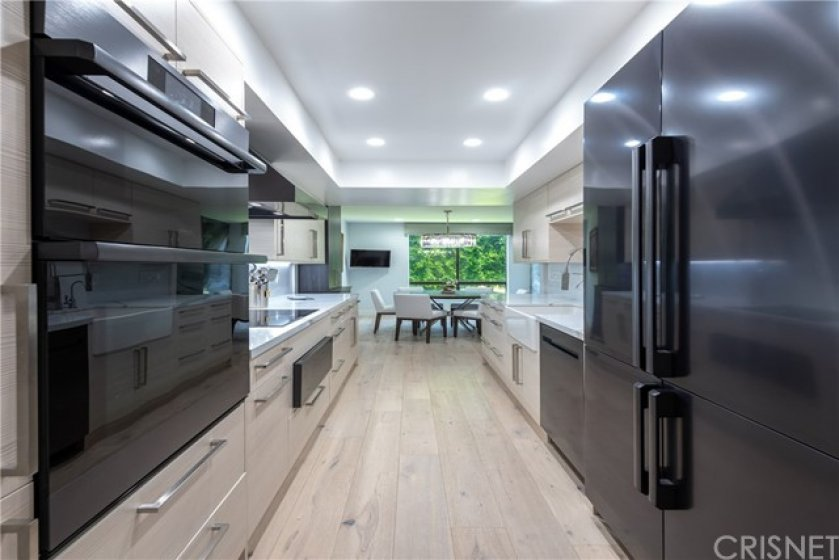 Top of The Line Dacor Graphite Stainless Modernest Series Appliances. Custom Cabinetry White Shaker w/Emtek Hardware. All Custom Made & Ordered for This Magnificent Condo.