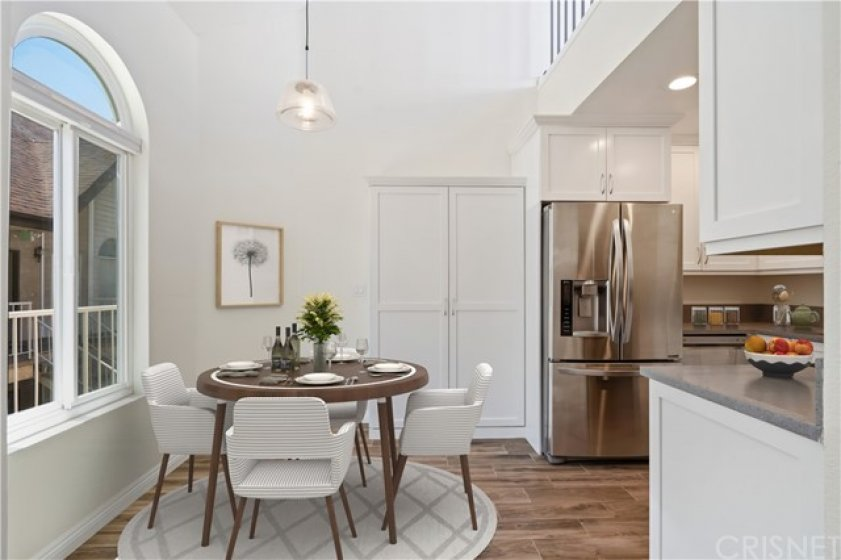Dining room attached to renovated kitchen with custom built in pantry - virtually staged