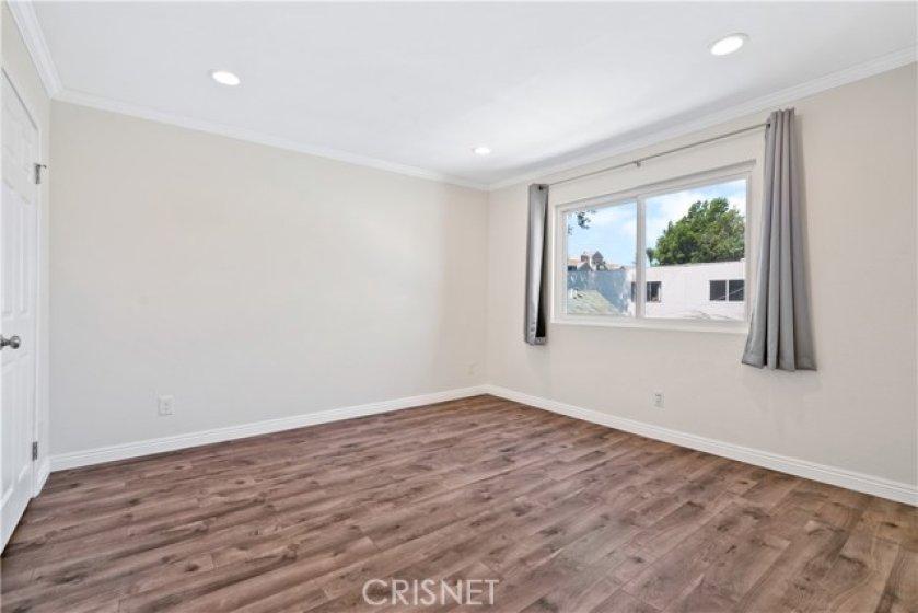 Primary suite with walk in closet and en-suite bath
