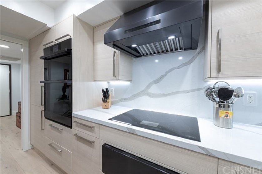 Extra Wide Food Preparation/Cooking Area. Featuring All Dacor Graphite Stainless Modernist Series Appliances. Dual Ovens,Warming Drawer,Loads of Storage, Self Closing Drawers, Emtek Hardware, Microwave/Steamer too.