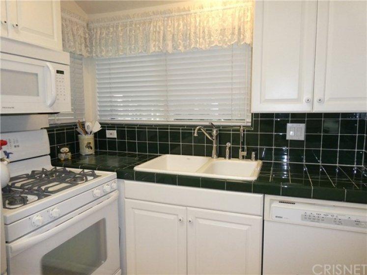 True quality custom built kitchen with serene garden views.