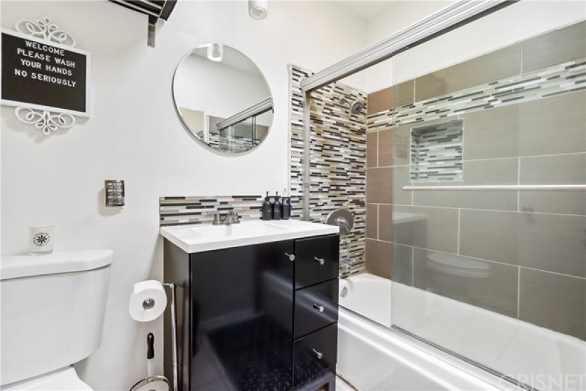 Updated bathroom with tub/shower.