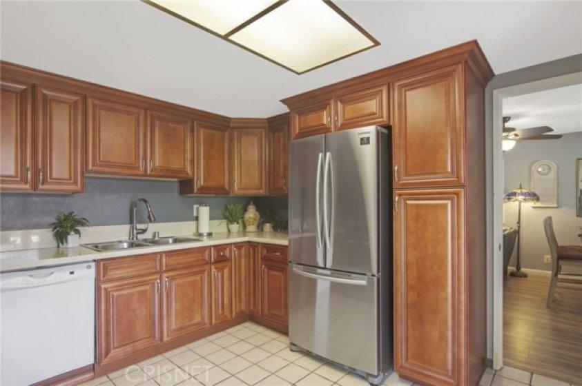 Kitchen with new Samsung French door refrigerator