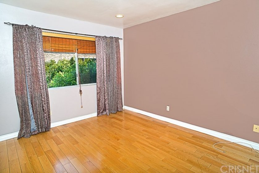 Second bedroom also with real hardwood floors and huge closet. Enjoy the nice green view! All 3 bedrooms have lots of natural light.