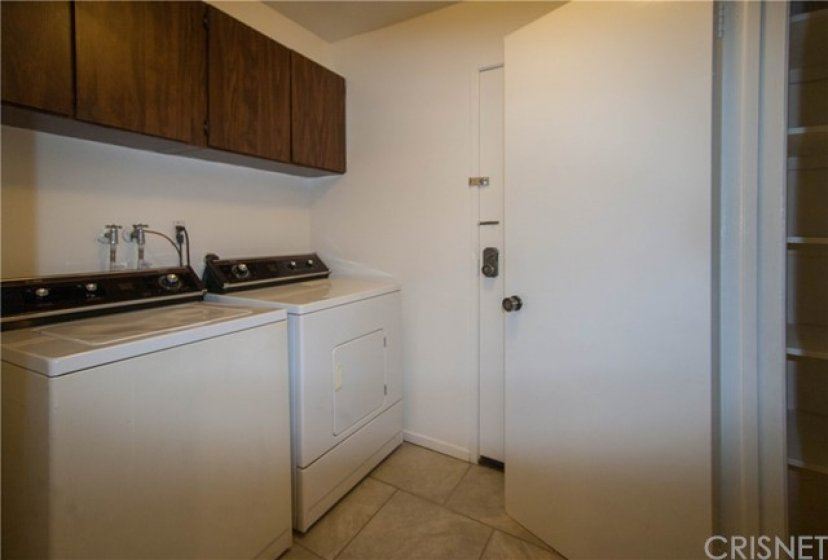 Private laundry room with washer and dryer included in sale.   Large Pantry for your convenience.
