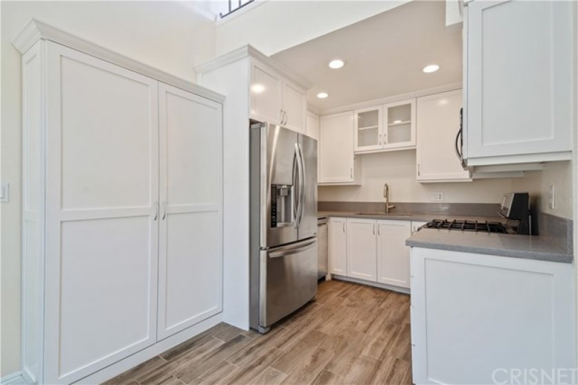 Fully renovated kitchen with marble counters, custom cabinets and amazing pantry!