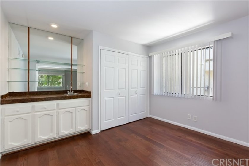 Bonus Room with Wet Bar and Closet w/Shelving & Cabinets