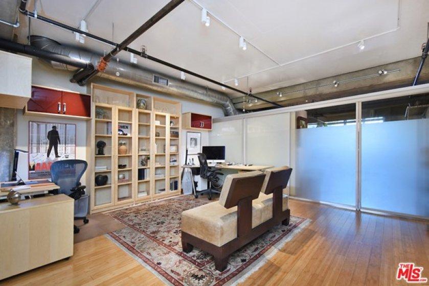 A Sliding Gla Door Offers Privacy in e st Floor Office/Bedroom