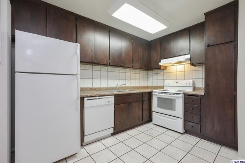 Kitchen with re-stained and varnished cabinets.
