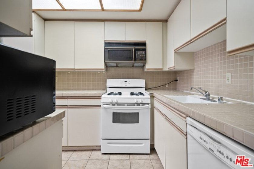 microwave, garbage disposal and refrigerator are fairly new