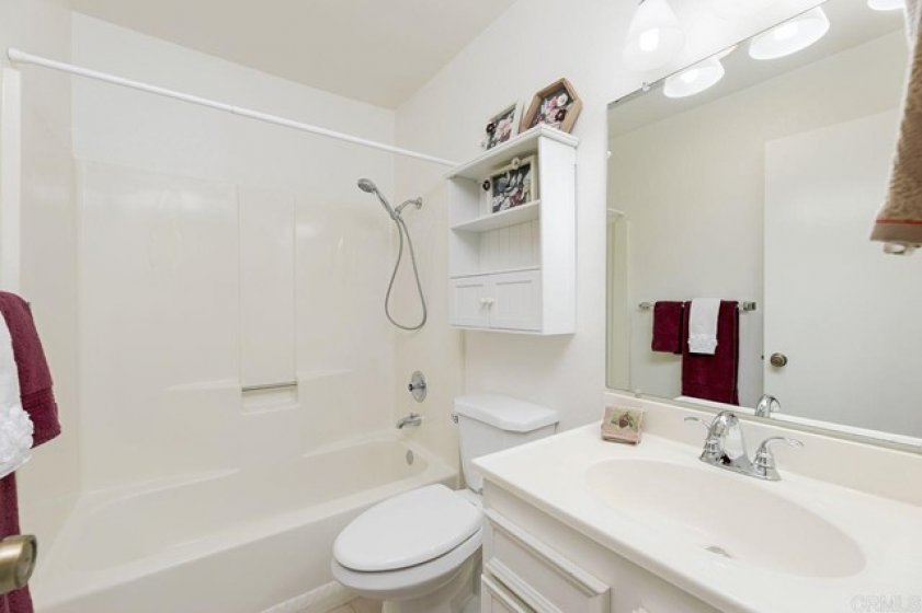 Guest bathroom shows clean & bright! Both bathrooms have solar tubes!