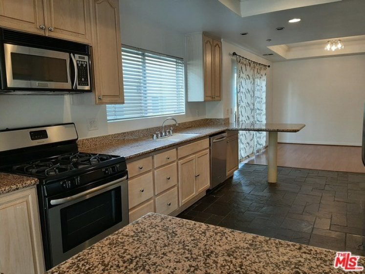 Granite tops and lots of cabinets