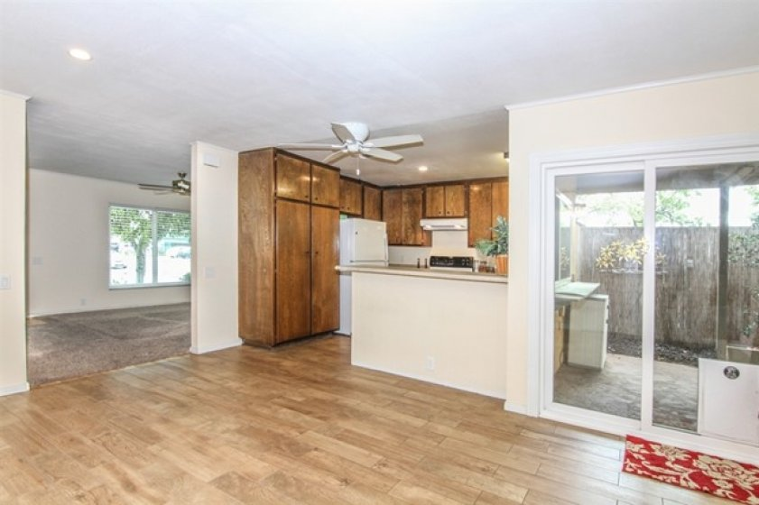 Kitchen looks out to large area that can be the family room or more formal dining area