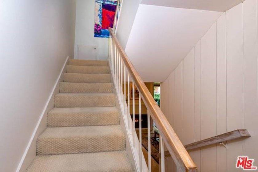 Stairs to den and master