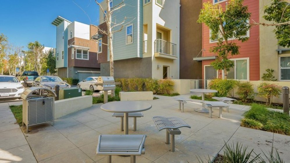 Shared courtyard with dining and BBQ