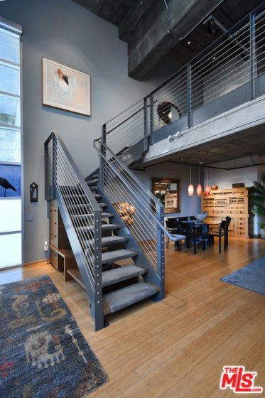 L-Shaped Staircase Leading Up to e nd Floor