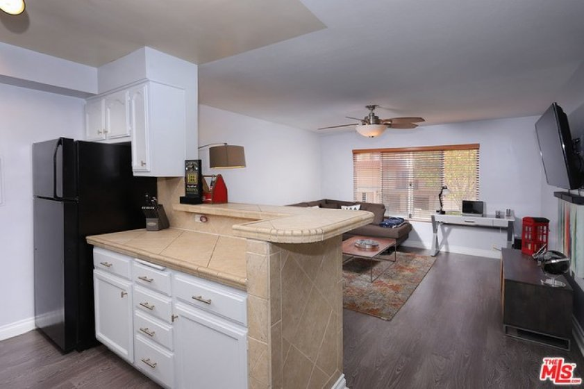 Kitchen opens to e living room.