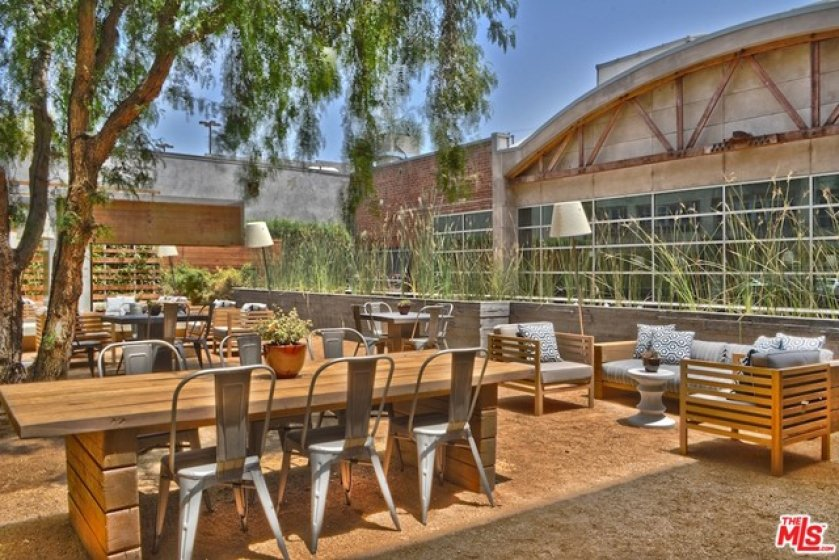HOA Courtyard wi Firepit and Tables for Eating or Working