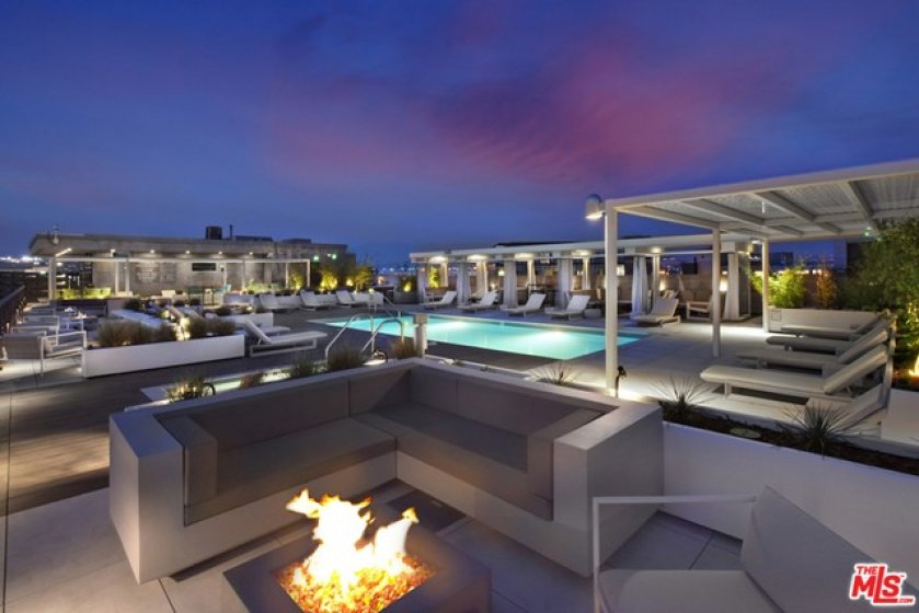 ... And Several Firepits Acro e Front of e Building