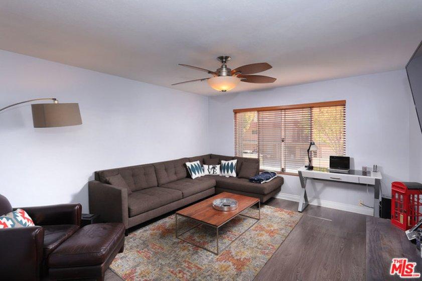 New flooring, smoo ceilings, ceiling fan, Souern exposure, bright and open floor plan.