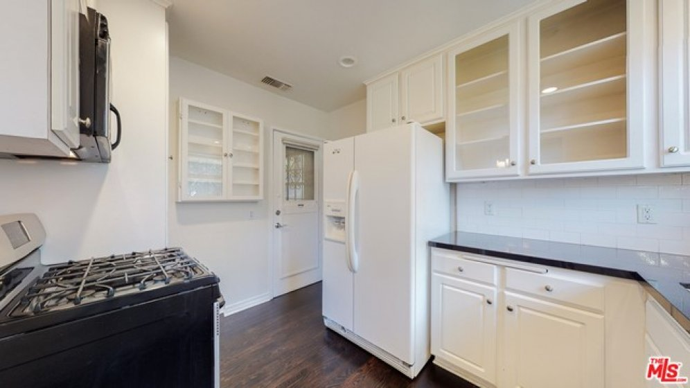 Kitchen has a separate back door entry.