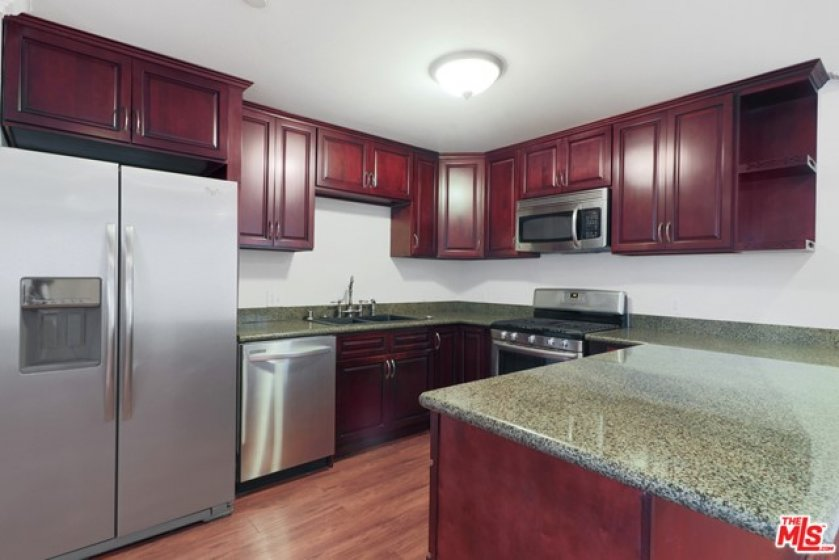 Renovated kitchen wi granite countertop and stainle steel appliances