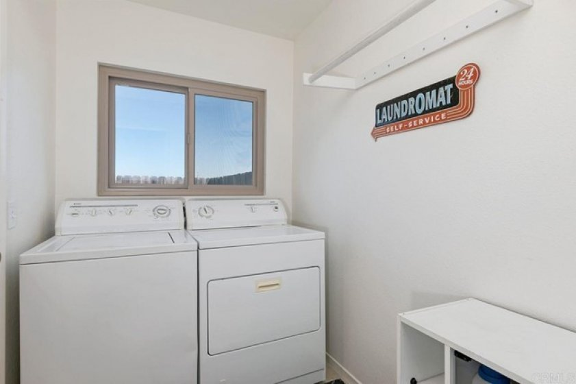 The laundry room is clean and bright!  The washer and dryer is not to convey.