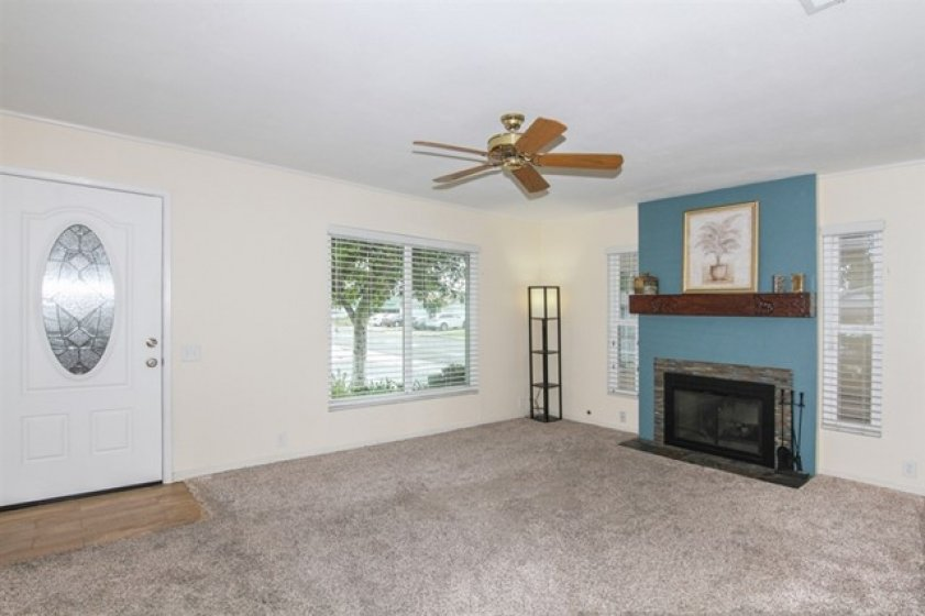 Very spacious with fireplace and big front window and 2 side windows.
