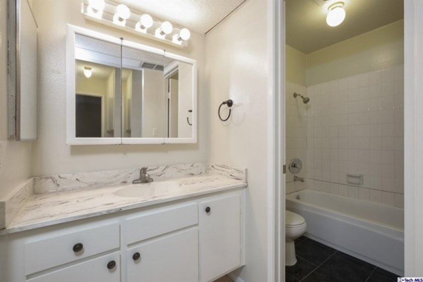 Upstairs bath room with shower over tub.