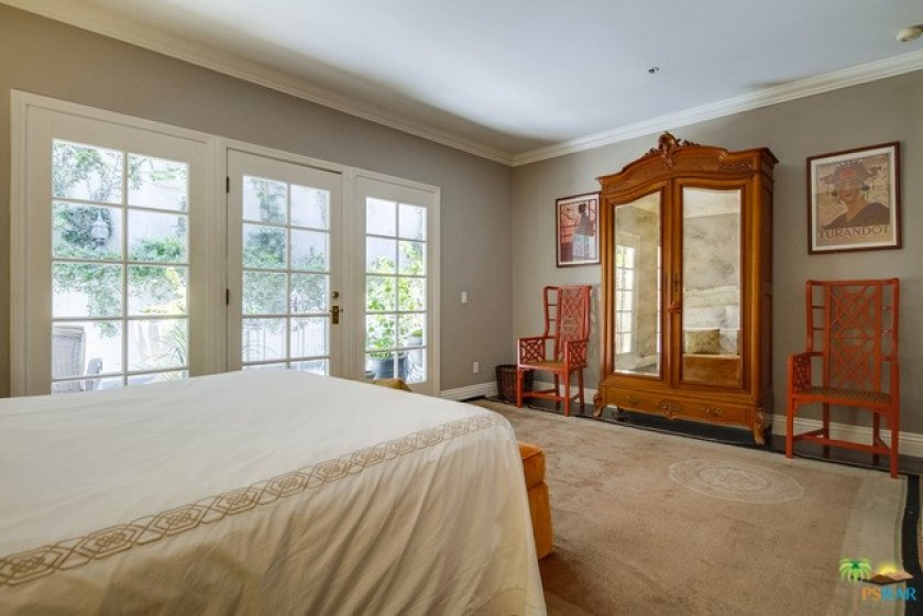 Master suite w/ french doors to patio